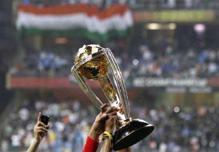 Members of India's squad hold the trophy during celebrations after they defeated Sri Lanka during their ICC Cricket World Cup final match in Mumbai April 2, 2011.       REUTERS/Andrew Caballero-Reynolds