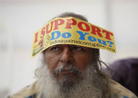 A demonstrator wears a sticker on his forehead during a protest rally against corruption in Mumbai, April 5, 2011. REUTERS/Danish Siddiqui