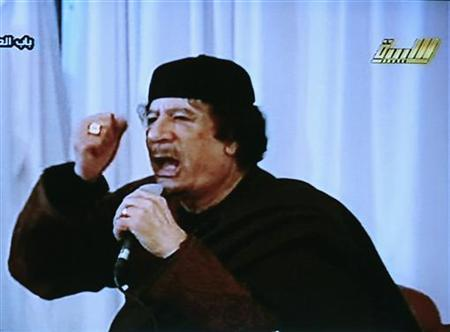 Libya's leader Muammar Gaddafi appears in a live broadcast on state television in Tripoli, March 15, 2011. REUTERS/LIBYIAN TV via Reuters TV