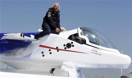Virgin Group head Sir Richard Branson sits on top of a solo piloted submarine during a photo opportunity at a news conference in Newport Beach, California April 5, 2011. REUTERS/Alex Gallardo