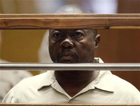 Lonnie David Franklin Jr. stands in court during his arraignment on 10 counts of murder and one count of attempted murder in Los Angeles Criminal Court in this July 8, 2010 file photo. REUTERS/Al Seib/Pool