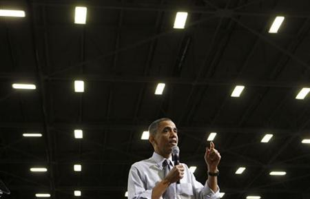 U.S. President Barack Obama takes questions during a town hall discussion about clean energy while visiting Gamesa Technology Corporation in Fairless Hills, Pennsylvania, April 6, 2011. REUTERS/Larry Downing