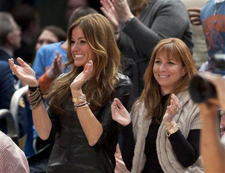 Kelly Bensimon (L) and Ramona Singer, two of the stars of the new reality television series ''The Real Housewives of New York City'', cheer during the Washington Wizards NBA basketball game with the New York Knicks at Madison Square Garden in New York January 24, 2011. REUTERS/Ray Stubblebine
