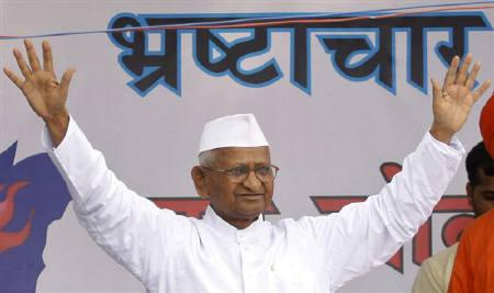 Social activist Anna Hazare waves to his supporters after he called off his hunger strike during a campaign against corruption in New Delhi April 9, 2011. REUTERS/Parivartan Sharma