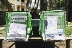 <p>A Nigerian police officer watches over ballot boxes in Ikoyi, Lagos, April 9, 2011. Africa's most populous nation voted in a delayed parliamentary election on Saturday, determined to hold a credible poll despite chaotic organization and violence. REUTERS/Nick Tattersall (NIGERIA - Tags: POLITICS ELECTIONS)</p>