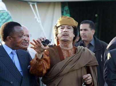 Libyan leader Muammar Gaddafi stands outside a tent erected at his Bab al-Aziziya residence in Tripoli April 10, 2011. Gaddafi, making his first appearance in front of the foreign media in weeks, joined a visiting African Union delegation at his Bab al-Aziziyah compound in Tripoli on Sunday. REUTERS/Louafi Larbi