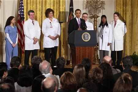 President Barack Obama speaks about healthcare reform, surrounded by health care personnel, from the East Room of the White House in Washington March 3, 2010. REUTERS/Larry Downing