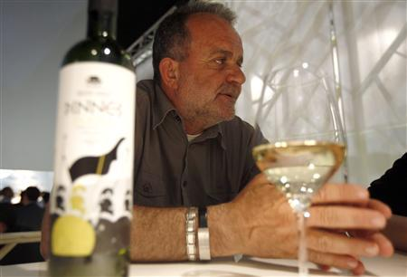 Bosnian Journalist and wine maker Alija Lizde talks with a Reuters journalist during the Vinitaly wine expo in Verona, April 8, 2011. REUTERS/Stefano Rellandini