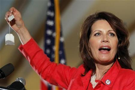 U.S. Congresswoman Michele Bachmann (R-MN), a potential Republican candidate for President, holds up a tea bag while speaking at the New Hampshire GOP Brunch in Nashua, New Hampshire March 12, 2011. REUTERS/Brian Snyder