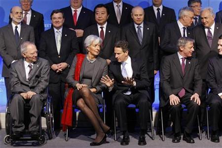 Finance ministers and central bank governors pose for a family photo during a meeting of G20 finance ministers and central bank governors at the Bercy Finance Ministry in Paris February 19, 2011. First row : Germany's Economy Minister Wolfgang Schaeuble, France's Economy Minister Lagarde, U.S. Treasury Secretary Timothy Geithner and Bank of France Governor Christian Noyer. REUTERS/Benoit Tessier
