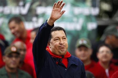 Venezuela's President Hugo Chavez waves to supporters during a ceremony to commemorate the ninth anniversary of his return to power after a brief coup, in Caracas April 13, 2011. REUTERS/Jorge Silva