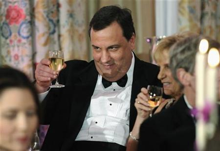 New Jersey Governor Chris Christie (C) shares a toast with his table mates as President Barack Obama (not pictured) plays host to a dinner for the National Governor's Association at the White House in Washington, February 27, 2011. REUTERS/Jonathan Ernst