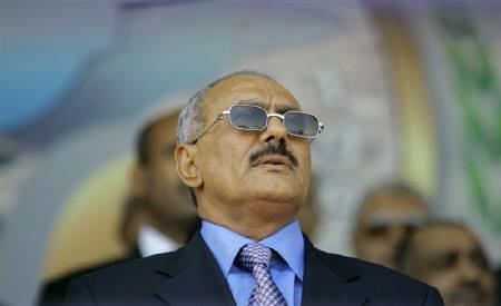 Yemen's President Ali Abdullah Saleh stands for the national anthem during a ceremony in the southern city of Taiz, in this May 22, 2010 file photo. REUTERS/Khaled Abdullah/Files
