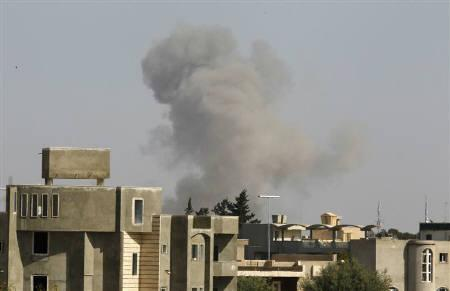 Smoke rises after a NATO and coalition air strike in Tripoli April 14, 2011. REUTERS/Zohra Bensemra
