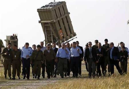Israel's Prime Minister Benjamin Netanyahu (C) walks with air force chief Major-General Ido Nehushtan (5th R) and Defence Minister Ehud Barak (5th L) during a visit to an Iron Dome unit in the coastal city of Ashkelon, north of the Gaza Strip April 10, 2011. REUTERS/Amir Cohen