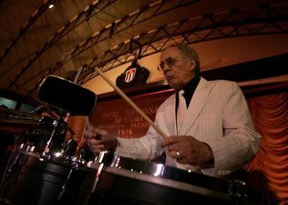 Timbal percussionist Amadito Valdes, 62, of Cuba's trademark Buena Vista Social Club band performs during a concert in Havana April 1, 2008. REUTERS/Enrique De La Osa (CUBA)