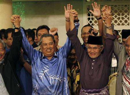 Malaysia's Sarawak State Chief Minister Abdul Taib Mahmud (R) and Deputy Prime Minister Muhyiddin Yassin celebrate after winning the Sarawak state elections in Kuching April 16, 2011. REUTERS/Bazuki Muhammad