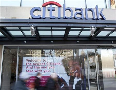 People walk by Citi's new flagship branch at Union Square in New York, December 16, 2010. REUTERS/Shannon Stapleton