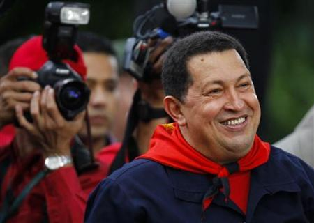 Venezuela's President Hugo Chavez smiles during a ceremony to commemorate the ninth anniversary of his return to power after a brief coup, in Caracas April 13, 2011. REUTERS/Jorge Silva