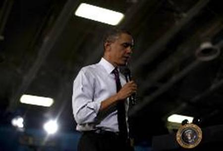 President Barack Obama answers questions from the audience at a town hall at Northern Virginia Community College, Annandale Campus in Annandale, Virginia, April 19, 2011. REUTERS/Jim Young