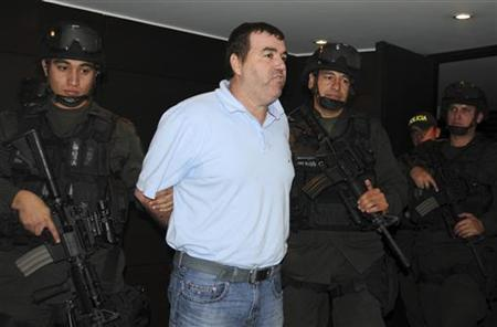 Colombian police escort Walid Makled at the police headquarters in Bogota, August 20, 2010. REUTERS/Colombian National Police