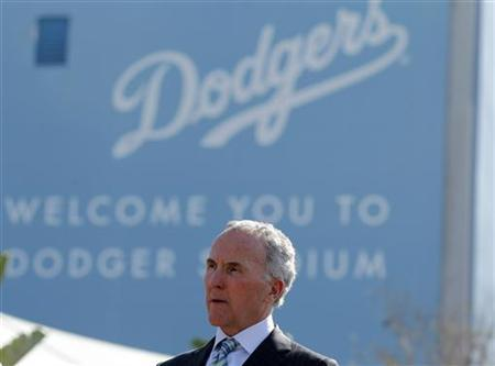 Los Angeles Dodgers owner Frank McCourt listens at a news conference about increased security at Dodger Stadium in Los Angeles, California, April 14, 2011. REUTERS/Lucy Nicholson