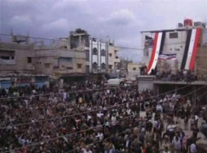 A still image taken from amateur video purportedly shows anti-government demonstrators rallying in Jasim, Deraa Governorate, April 22, 2011. REUTERS/Amateur Video via Reuters TV