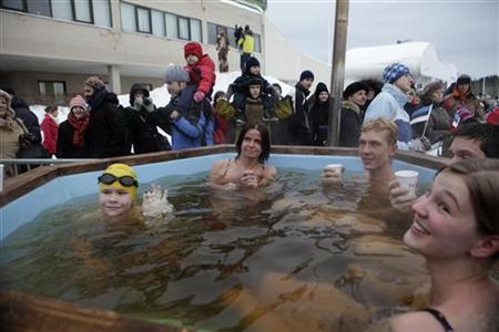 People soak in an open air hot bath at a winter swimming festival in Tallinn January 8, 2011. REUTERS/Ints Kalnins