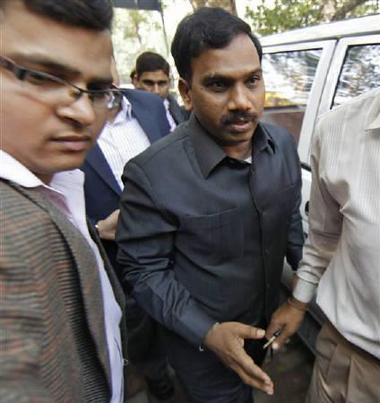 Former telecommunications minister Andimuthu Raja (C) arrives at a court for a hearing in New Delhi February 17, 2011. REUTERS/Adnan Abidi/Files