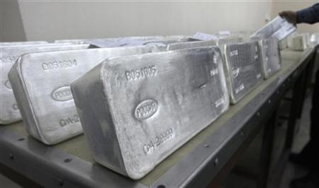 A worker stores ingots of 99.99 percent pure silver, which weigh 30 kilos (66 lbs), to pack them at the Krastsvetmet nonferrous metals plant in Russia's Siberian city of Krasnoyarsk, March 28, 2011. REUTERS/Ilya Naymushin