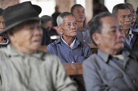 Elderly residents watch television at a free tea house for local elderly people in Chengmai county, Hainan province December 4, 2010. REUTERS/Sheng Li