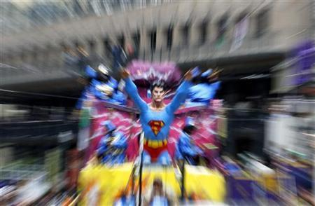 A float decoration of fictional character Superman is seen as members of the Krewe of Zulu march down St. Charles Avenue on Mardi Gras Day in New Orleans, Louisiana March 8, 2011. REUTERS/Sean Gardner