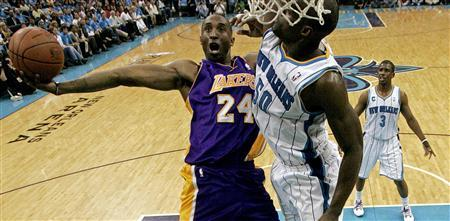 Los Angeles Lakers' Kobe Bryant (L) shoots over New Orleans Hornets' Emeka Okafor during Game 6 of their NBA Western Conference first round playoff basketball game in New Orleans, Louisiana April 28, 2011. REUTERS/Sean Gardner