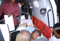 <p>Uganda's Forum for Democratic Change (FDC) leader Kizza Besigye leaves in an ambulance at the Jomo Kenyatta International Airport (JKIA) in Kenya's capital Nairobi April 29, 2011. Ugandan opposition leader Besigye flew to Kenya on Friday to seek treatment for injuries received during his arrest on Thursday, opposition and airline officials said. REUTERS/Stringer</p>