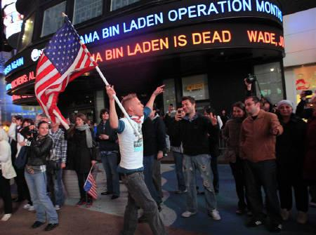 People react to the death of Osama bin Laden in Times Square in New York early May 2, 2011. REUTERS/Eric Thayer