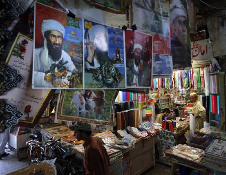 Images of al Qaeda leader Osama bin Laden are displayed for sale at a market in Quetta May 2, 2011. REUTERS/Naseer Ahmed