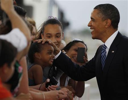 President Barack Obama greets supporters after arriving aboard Air Force One at Miami International Airport in Florida, April 29, 2011. REUTERS/Larry Downing