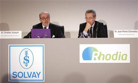 Solvay Chief Executive Christian Jourquin (L) and Rhodia Chief Executive Jean-Pierre Clamadieu attend a joint news conference in Paris April 4, 2011. REUTERS/Benoit Tessier