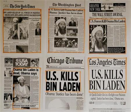 Newspaper headlines and clippings are posted on a wall inside a staff office at the White House in Washington May 2, 2011, the morning after U.S. President Barack Obama announced the death of Osama bin Laden. REUTERS/Jason Reed