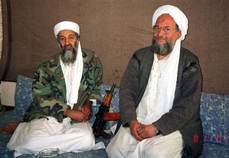 Osama bin Laden (L) sits with Al Qaeda's top strategist and second-in-command Ayman al-Zawahri in this 2001 file photo. REUTERS/Hamid Mir/Editor/Ausaf Newspaper for Daily Dawn/File