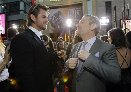 Director of the movie Kenneth Branagh (R) greets cast member Chris Hemsworth at the premiere of ''Thor'' at the El Capitan theatre in Hollywood, California May 2, 2011. REUTERS/Mario Anzuoni