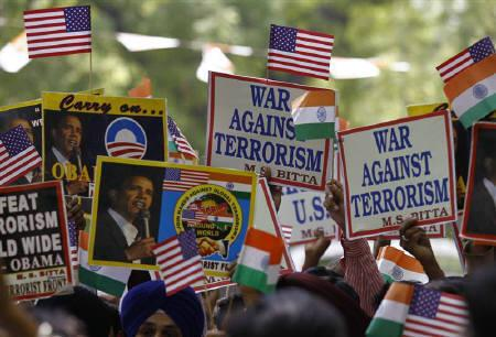 Members of the All India Anti-Terrorist Front (AIATF) hold placards and U.S. and Indian flags in New Delhi May 3, 2011, during a pro-U.S. rally as they celebrate the killing of Osama bin Laden. REUTERS/Adnan Abidi