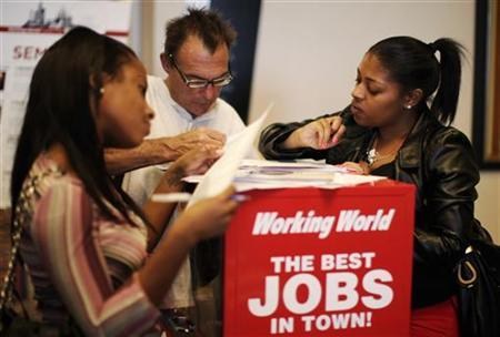 People fill out job application forms at a job fair in Los Angeles, October 13, 2010. REUTERS/Lucy Nicholson