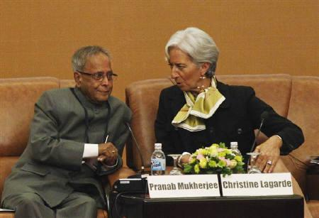 France's Finance and Economy Minister Christine Lagarde (R) chats with India's Finance Minister Pranab Mukherjee while attending a governor seminar session ''Asia 2050: Pursuit of growth, sustainability and well being'' during the 44th annual meeting of ADB in Hanoi May 4, 2011. REUTERS/Nguyen Huy Kham