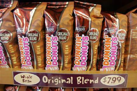 One pound bags of Dunkin' Donuts Original Blend coffee are on display at a Dunkin' Donuts store in Tewksbury, Massachusetts December 20, 2005.  REUTERS/Jessica Rinaldi/Files