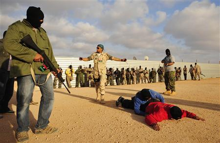 Rebel fighters take part in a training session in Benghazi May 5, 2011. REUTERS/Esam al-Fetori
