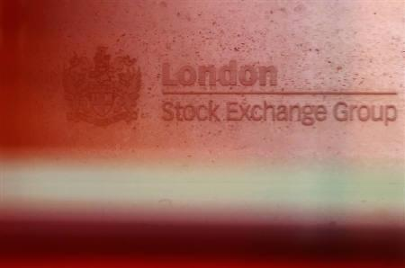 A red London bus passes the Stock Exchange  in London February 9, 2011. REUTERS/Luke MacGregor/Files