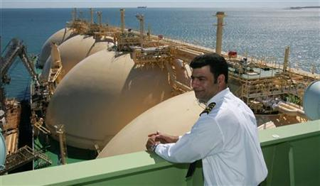 Cornelius Johnston, master of the gas transport ship North West Eagle overlooks the first shipment of LNG (Liquefied Natural Gas) to depart from the Pilbara region of Western Australia for China May 17, 2006. REUTERS/Kerry Edwards/Pool