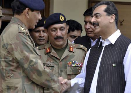 Pakistan's Prime Minister Yusuf Raza Gilani (R) shakes hands with Pakistani Army Chief Ashfaq Parvez Kayani at an army headquarters in Multan  September 12, 2010. REUTERS/Asim Tanveer/Files
