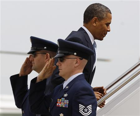 President Obama boards Air Force One at Andrews Air Force Base near Washington, May 10, 2011. REUTERS/Jim Young